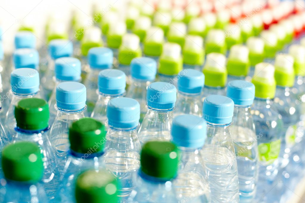 Image of many plastic bottles with water in a shop  Foto de Stock   #11581430