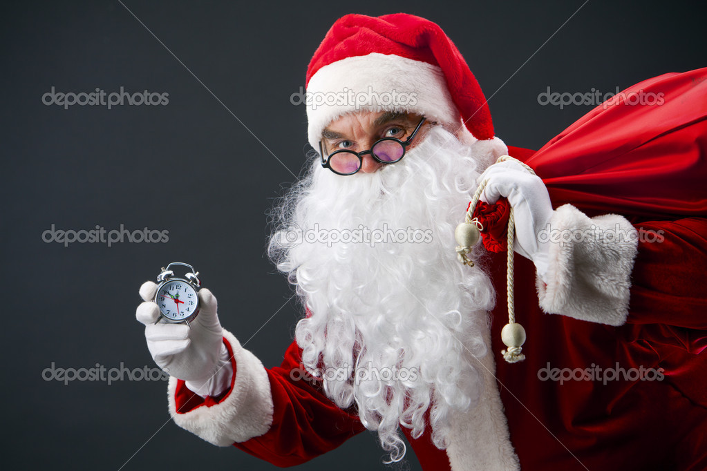 Santa looking at camera and showing face of clock — Stock Photo #11582543