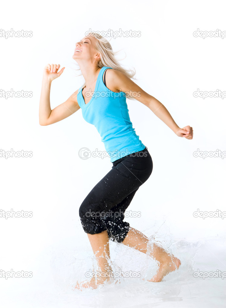 Portrait of blond female laughing while splashing water over white background  Stock Photo #11583775