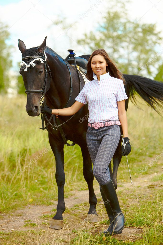 Image of happy female with purebred horse outdoors — Stock Photo #11583921