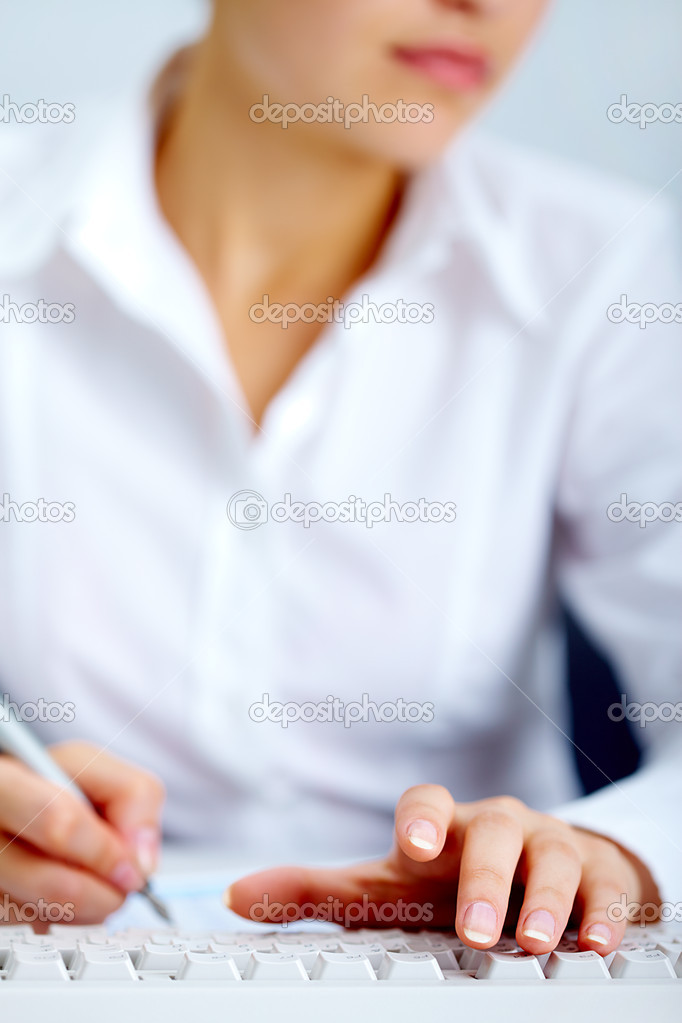 Close-up of female hand touching buttons of white computer keyboard — Stock Photo #11584130