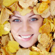 Face in foliage - Stock Photo