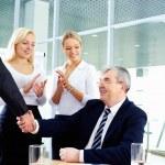Handshake of boss — Stock Photo