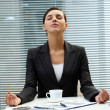 Stock Photo: Meditating employer