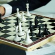 Figures on chessboard - Stock Photo