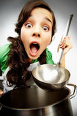Girl with a ladle — Stock Photo