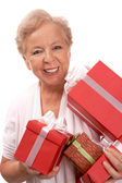 Woman with giftboxes — Stock Photo