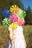 Pinwheel in hand — Stock Photo