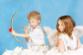 Two cupids — Stockfoto