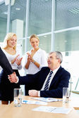 Handshake of boss — Stock Photo