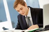Businessman reading — Stock Photo