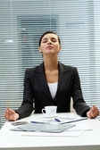 Meditating employer — Stock Photo