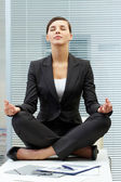 Meditating on table — Stock Photo