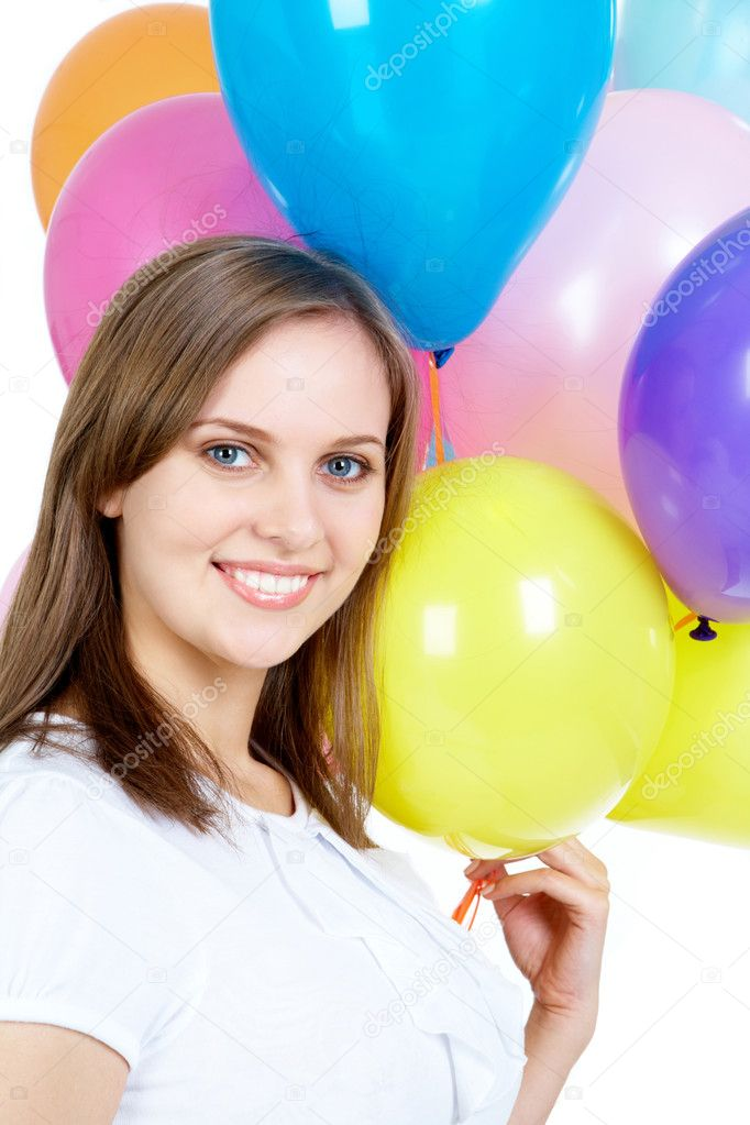 Pretty young woman holding balloons and looking at camera — Stock Photo #11627247