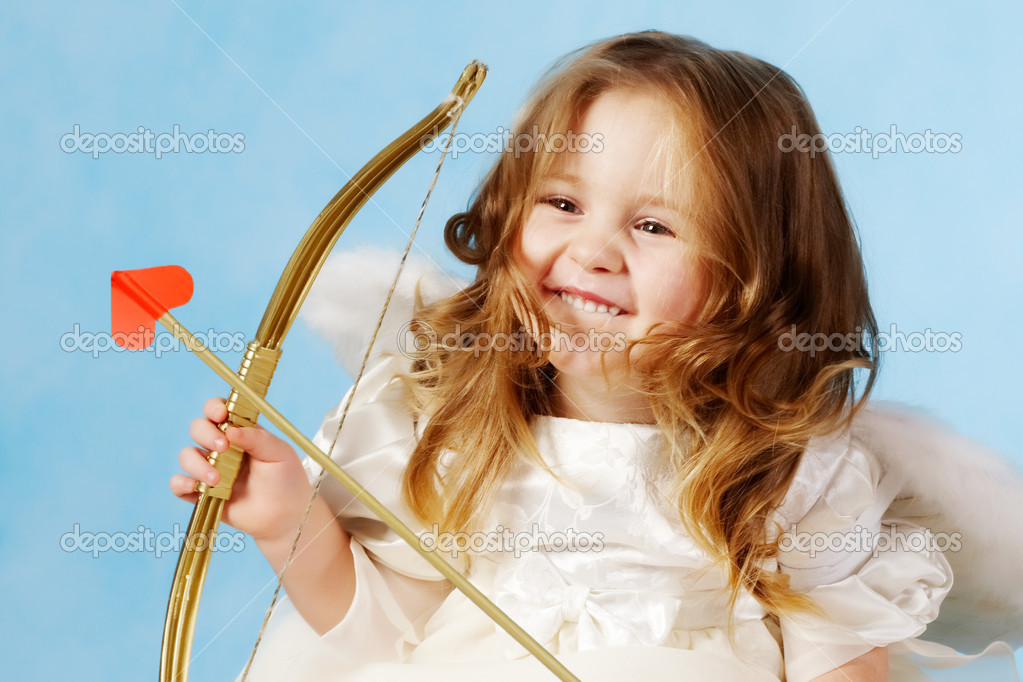 Cute female cupid holding bow — Stock Photo #11628349