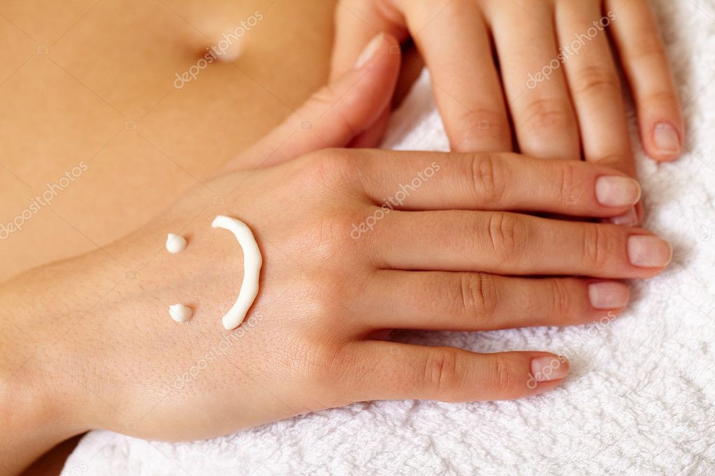 Image of female manicured hands on soft towel with cream smile on surface — Stock Photo #11628781