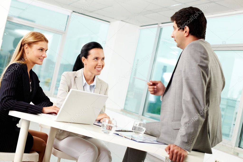 Three business discussing ideas at workplace in office — Stock Photo #11629564