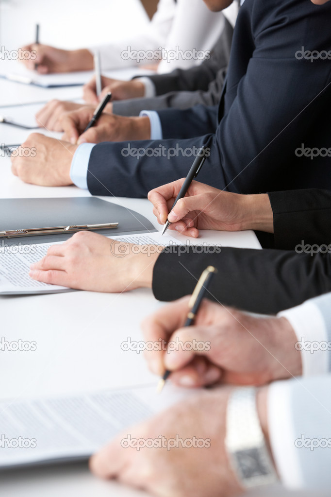 Close-up of human hands with pens over business documents  Stock Photo #11629912