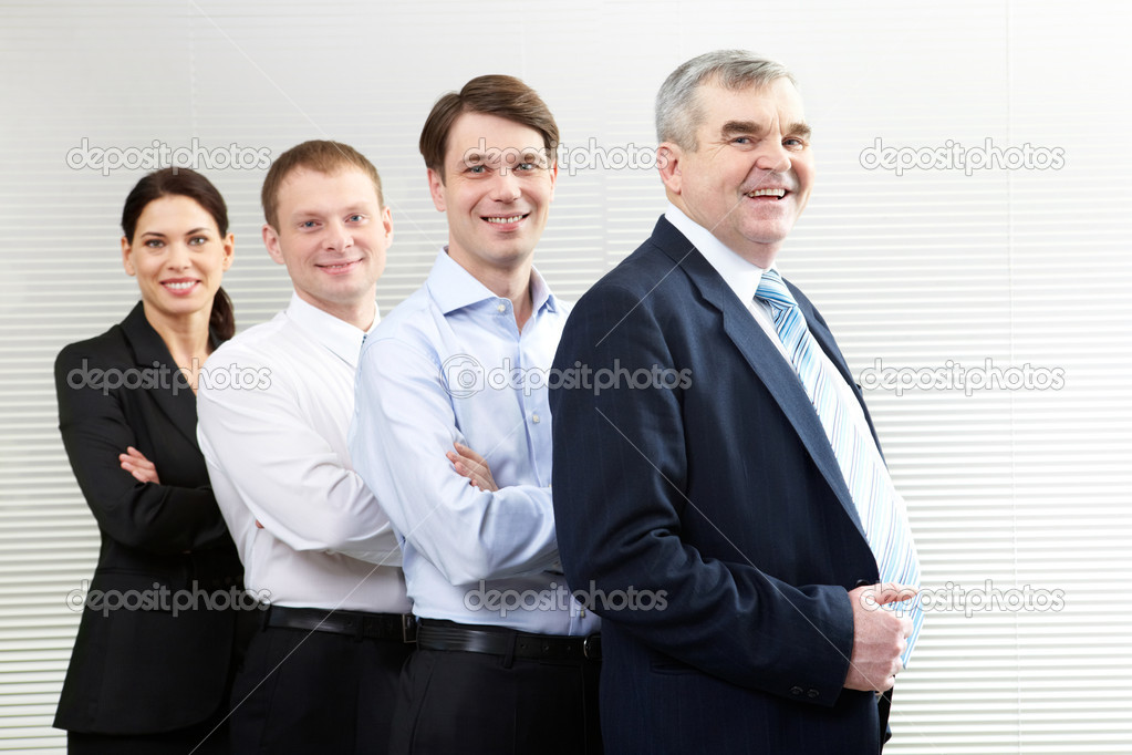 Portrait of a business team of four looking at camera and smiling — Stock Photo #11629944