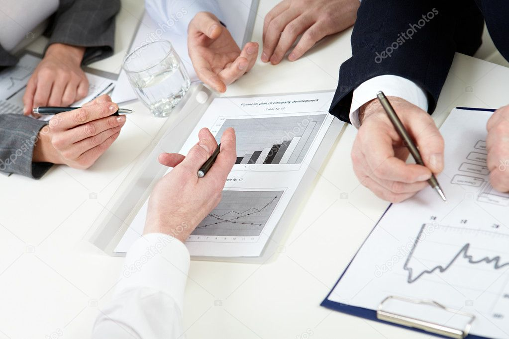 Close-up of hands of business and graphics — Stock Photo #11629957