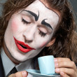 Clown with coffee - Stock Photo