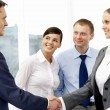 Stock Photo: Handshaking partners