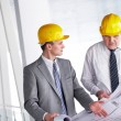 Discussing blueprint — Stock Photo #11631501