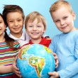Children with globe — Stock Photo