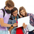 Friends with laptop — Stock Photo