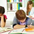 Students writing — Stock Photo