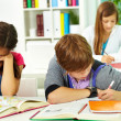 Stock Photo: Students writing