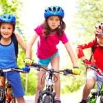 Children on bikes — Stock Photo