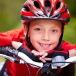 Little boy's face on bike — Stock Photo