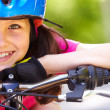 Stock Photo: Little girl's face on bike