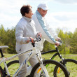 Cycling couple - Stockfoto