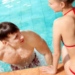 Couple in pool — Stock Photo #11634362