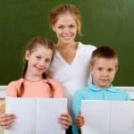 Teacher and schoolkids — Stock Photo #11634532