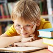 Boy in library — Stock fotografie