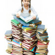 Girl on books — Stock Photo