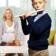 Cute flutist - Stock Photo