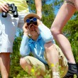 Stock Photo: Looking through binoculars