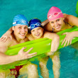 Foto Stock: Family of swimmers