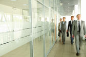 Businesspeople in corridor — Stock Photo