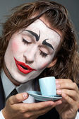Clown with coffee — Stock Photo