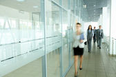 Businesspeople in corridor — Stock Photo