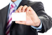 Business card in hand — Stock Photo