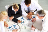 Discussing business schemes — Stock Photo