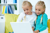 Twins with laptop — Stock Photo