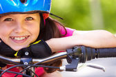 Little girl's face on bike — Stock Photo