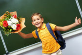 Boy with flowers — Stock Photo